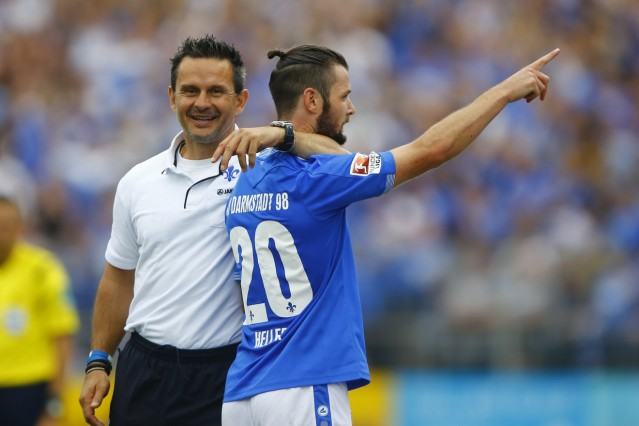 SV Darmstadt 98's Heller celebrates his second goal with coach Schuster during their German first division Bundesliga soccer match against Hanover 96 in Darmstadt
