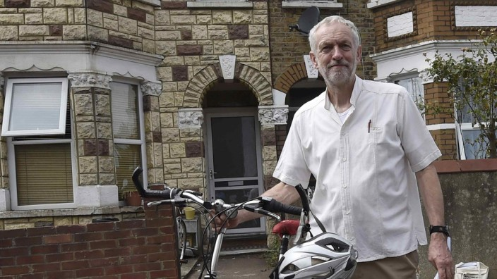 British Labour Party politician Corbyn arrives for a community meeting in north London