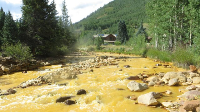US anti-pollution workers turn river orange in toxic spill