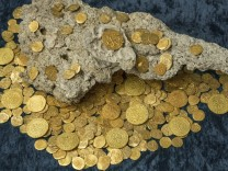 Over 350 gold coins recovered from Spanish shipwreck near Florida are seen in an undated handout picture