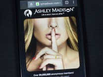 A photo illustration shows the Ashley Madison website displayed on a smartphone in Toronto