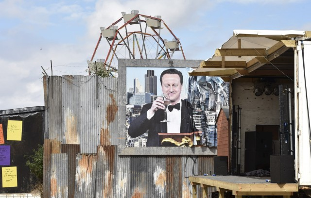 A poster is pictured at 'Dismaland', a theme park-styled art installation by British artist Banksy, at Weston-Super-Mare in southwest England
