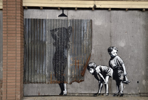A mural is pictured at 'Dismaland', a theme park-styled art installation by British artist Banksy, at Weston-Super-Mare in southwest England