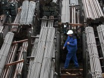 File picture of a worker walking through finished steel bars