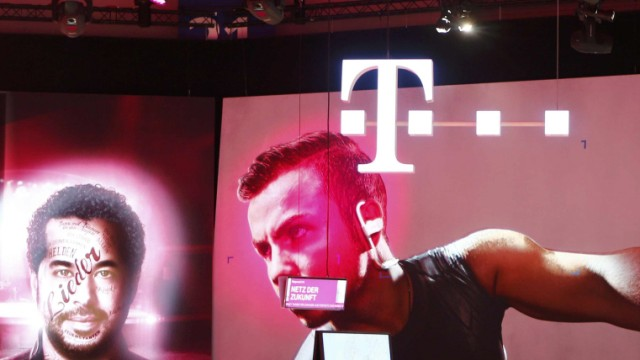 Workers prepare the booth of the company Deutsche Telekom at the IFA Electronics show in Berlin