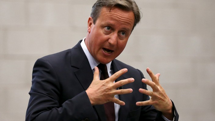 Britain's Prime Minister Cameron delivers a speech to an audience of pupils during a visit to Corby Technical School at Corby in central England