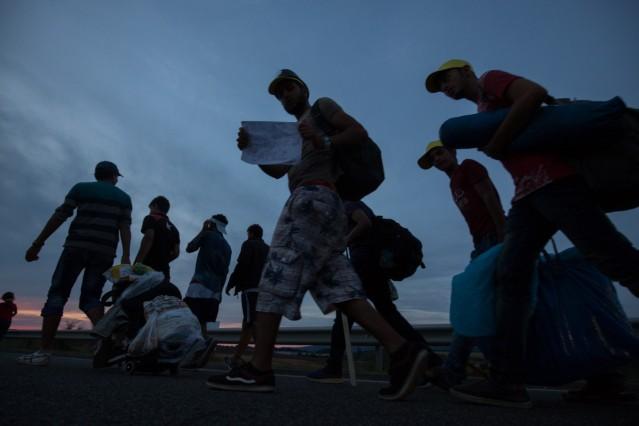 Migrants March Towards Austria
