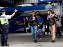 Flüchtlinge, die in München aus Ungarn ankommen