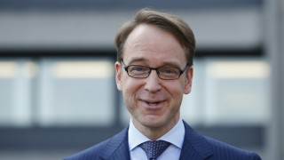Weidmann, chief of Germany's Bundesbank, smiles as he arrives for the yearly news conference in Frankfurt