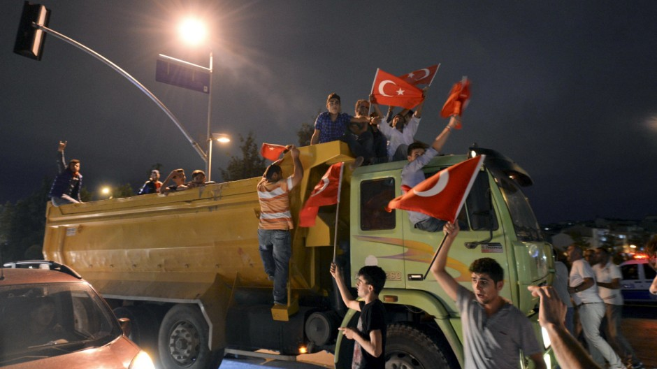 Demonstrators shout nationalist slogans during a protest in front of the headquarters of the Hurriyet daily newspaper in Istanbul, Turkey