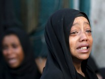 Girl cries after her father was killed by a Saudi-led air strike in Yemen's capital Sanaa