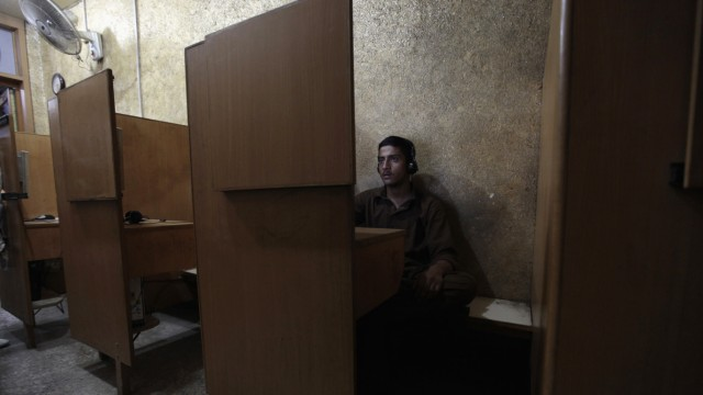 A man sits at an internet cafe in Rawalpindi