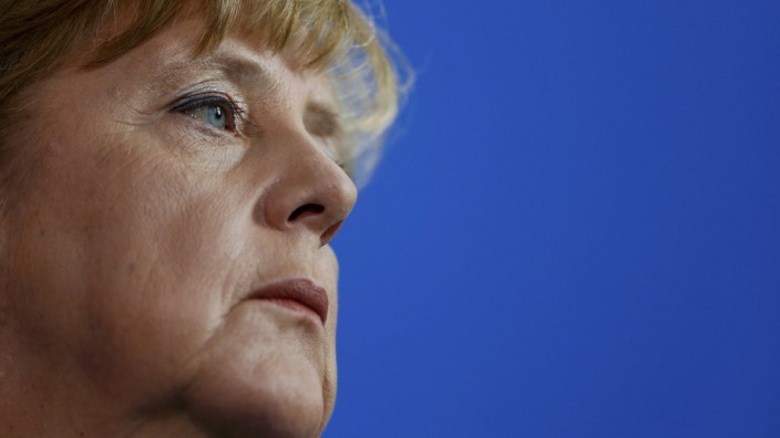 German Chancellor Merkel looks on at a news conference at the chancellery in Berlin