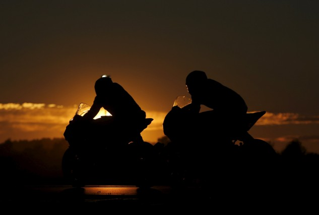 Competitors ride their motorcycles at sunset during the 79th Bol d'Or motorcycle endurance race at the Paul Ricard circuit in Le Castellet