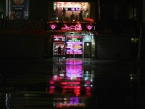 A sex shop is seen open near Times Square ahead of Hurricane Sandy in New York