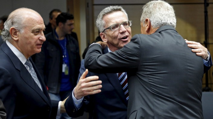Spanish Interior Minister Fernandez Diaz, his German counterpart de Maiziere and EU Commissioner Avramopoulos attend an extraordinary European Justice and Home Affairs ministers meeting in Brussels