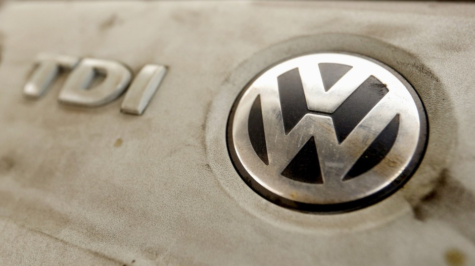 Volkswagen's logo is seen on a TDI diesel engine of its EOS car in Zurich