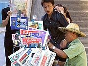 Zeitungsverkäufer, ap