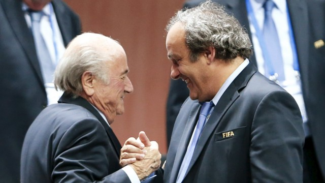File picture shows UEFA President Platini congratulating FIFA President Blatter after Blatter was re-elected at the 65th FIFA Congress in Zurich