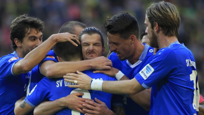 Darmstadt 98's Heller celebrates with his team mates scoring against Borussia Dortmund during Bundesliga soccer match in Dortmund