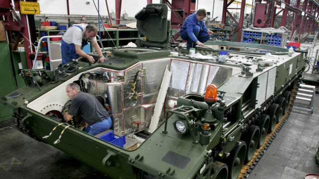 Employees work on the production line of the new PzH 2000 Ho