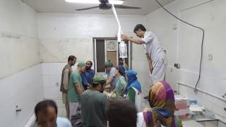 Afghan (MSF) surgeons work inside a Medecins Sans Frontieres (MSF) hospital after an air strike in the city of Kunduz, Afghanistan