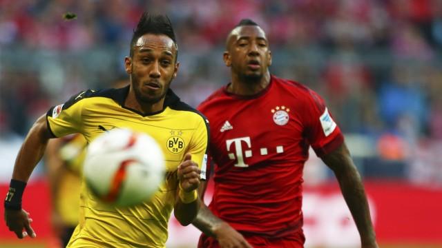 Borussia Dortmund's Aubameyang challenges Bayern Munich's Boateng during their German first division Bundesliga soccer match in Munich