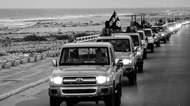 An image made available by propaganda Islamist media outlet Welayat Tarablos on February 18, 2015, allegedly shows members of the Islamic State (IS) militant group parading in a street in Libya's coastal city of Sirte