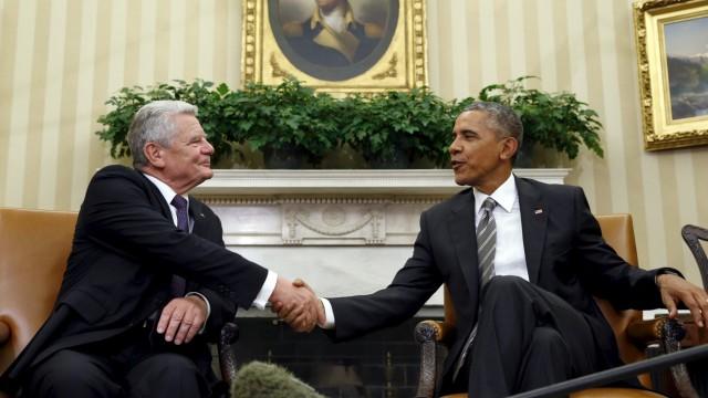 U.S. President Barack Obama meets German President Joachim Gauck in the Oval Office of the White House in Washington