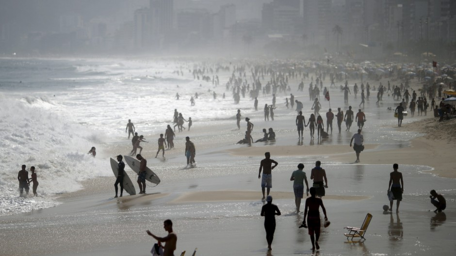 People gather in Ipanema beach in Rio De Janeiro