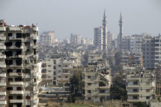 A general view shows damaged buildings in the northwestern Homs district of Al Waer
