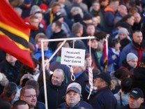 People gather for an anti-immigration demonstration organised by PEGIDA in Dresden