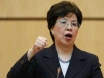 World Health Organisation Director-General Chan gestures during her address to the 68th World Health Assembly at the UN in Geneva