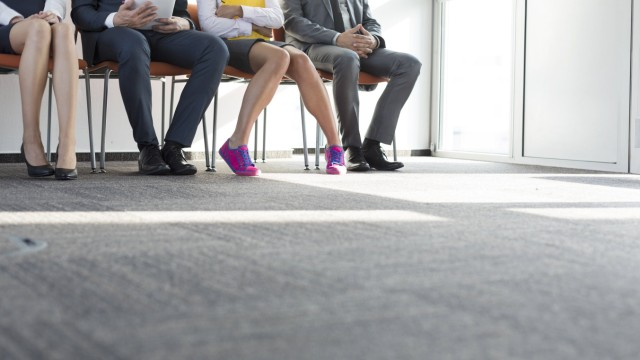 People sitting in a row waiting for job interview model released Symbolfoto property released PUBLI