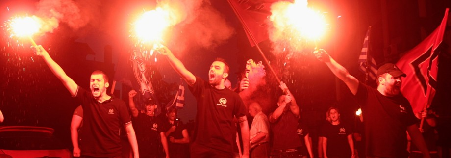 Members of extreme right party Golden Dawn celebrate holding flares in northern coastal city of Thessaloniki after Greece's general elections