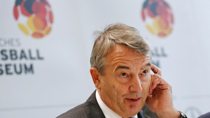Niersbach, the German Soccer Association President, reacts on stage at Germany's new soccer museum in Dortmund