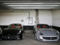 Two Ferrari cars which were gifts to former Spanish King Juan Carlos are seen before being auctioned in Madrid