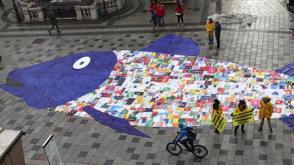 Plastic shopping bags in shape of a fish are laid out by Greenpeace in protest against pollution of oceans in Vienna