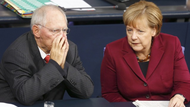 German Chancellor Merkel speaks to Finance Minister Schaeuble during session of Bundestag in Berlin