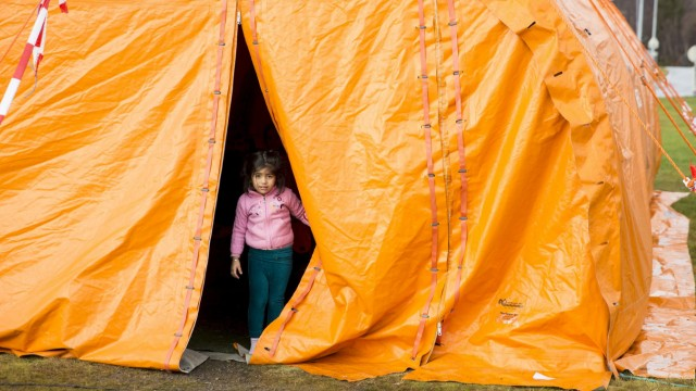 Girl looks out from a temporary reception centre at Storskog border station in northern Norway