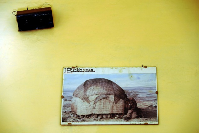 A tourism poster is seen on a wall inside a hotel in Asmara