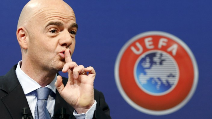 UEFA General Secretary Infantino asks the audience for silence before the draw for the play-off matches for UEFA Euro 2016 at the UEFA headquarters in Nyon