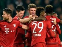 Munich's Mueller celebrates during their German cup (DFB Pokal) second round soccer match against VfL Wolfsburg
