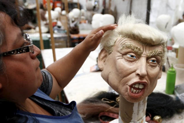 An employee works on a mask of Republican presidential candidate Trump at Grupo Rev in the Mexican city of Cuernavaca near Mexico City