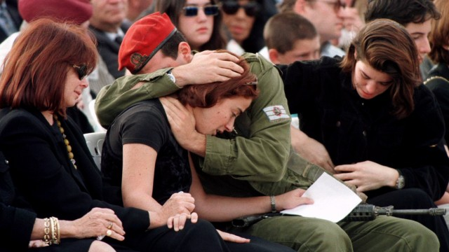 Slain Israeli Prime Minister Yitzhak Rabin's grandson Yonatan, an Israeli paratrooper, hugs his sist..