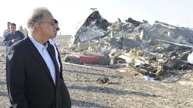 Egypt's Prime Minister Sherif Ismail looks at the remains of a Russian airliner after it crashed in central Sinai near El Arish city