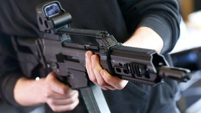 A man holds a G 36 KA rifle manufactured by Heckler & Koch at arms factory in Oberndorf