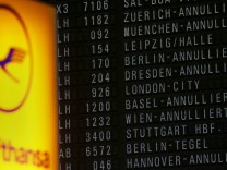 Cancelled flights of German air carrier Lufthansa are announced on a flight infomation display at the Frankfurt Airport