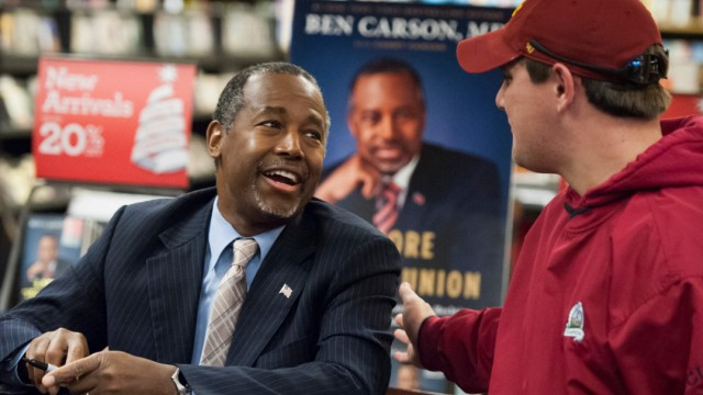 Dr. Ben Carson greets a supporter at a book tour stop in Ames, Iowa