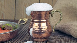Ayran - Traditional Turkish yoghurt drink in a copper metal cup